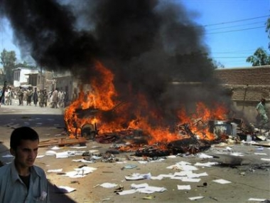 (11-May-05) A car burns in the street as university students protest in the steets in Jalalabad, Afghanistan <font size=-2>(Source: AP)</font>