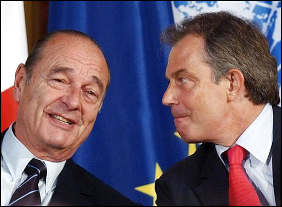 Tony Blair scowls angrily at grinning Jacques Chirac at &Eacute;lys&eacute;e Palace in Paris on Tuesday. <font size=-2>(Source: AP)</font>