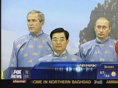 """George Bush, Russian President Vladimir Putin and Chinese President Hu Jintao enjoy a moment of cheer together at APEC, dressed in traditional """"ao dai"""" robes"""