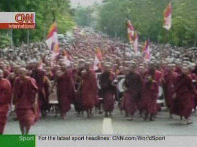 Tens of thousands of Buddhist monks demonstrated in Rangoon, forming a sea of red <font face=Arial size=-2>(Source: CNN)</font>