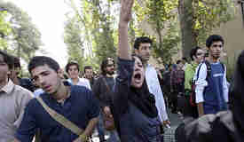 Tehran University students demonstrating and protesting against Ahmadinejad <font face=Arial size=-2>(Source: iht.com)</font>