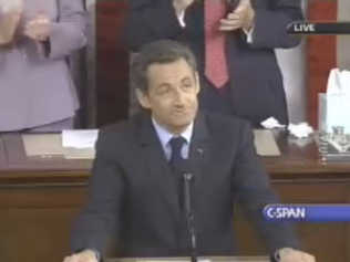 Sarkozy enjoys a standing ovation after praising American idealism <font face=Arial size=-2>(Source: C-SPAN)</font>