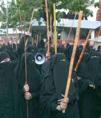 Protesting female students at Red Mosque seminary wearing burkas and carrying bamboo sticks