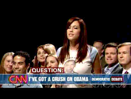 &quot;Obama Girl&quot; is selected as randomly chosen questioner on a <i>Saturday Night Live</i> skit mocking the press's adoration of Barack Obama.  Her &quot;question&quot; turns out to be her song, &quot;I've got a crush on Obama.&quot; <font size=-2>(Source: NBC)</font>