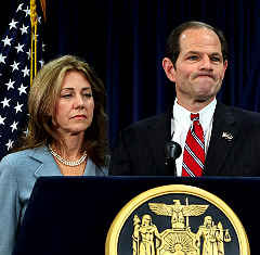A grim-faced Silda Spitzer stands by her man, Elliott Spitzer, as a prop at Monday's press conference. Spitzer's three daughters were not present.