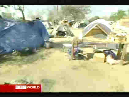 Tent City in Ontario, California, has grown to hundreds of homeless people. <font face=Arial size=-2>(Source: BBC)</font>