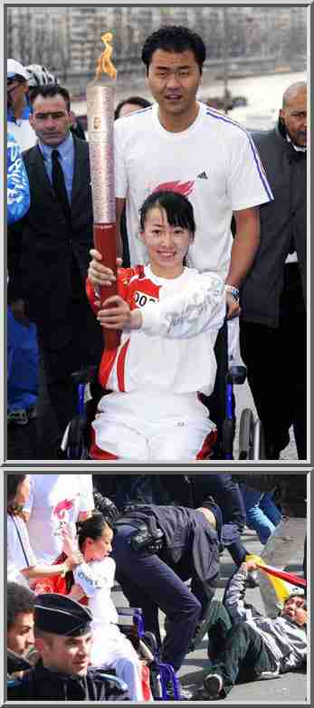 &quot;Torchbearer Jinjing (in wheelchair),a Chinese Para-Olympic athlete, protects the torch to resist protestors' disruptions as she runs along the Seine River in the Beijing Olympic torch relay in Paris, April 7, 2008.&quot; <font face=Arial size=-2>(Source: China Daily)</font>