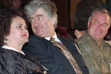 Radovan Karadzic, center, with his wife Ljiljana and Ratko Mladic <font face=Arial size=-2>(Source: Times Online)</font>