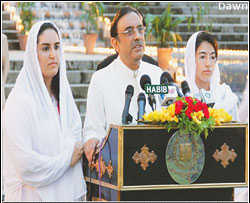 President-elect Asif ali Zardari, flanked by daughters Bakhtawar and Asifa, speaks to his party colleagues and supporters at the Prime Minister's House on Saturday evening. <font face=Arial size=-2>(Source: dawn.com)</font>
