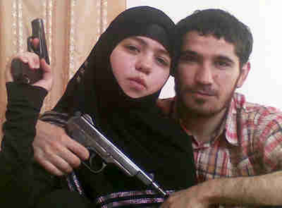 Female suicide bomber Dzhennet Abdurakhmanova and her husband, terrorist Umalat Magomedov. <font face=Arial size=-2>(Source: Moscow Times)</font>