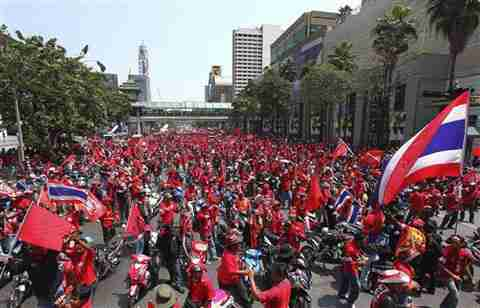 Bangkok Thailand - tens of thousands of red-shirted anti-government demonstrators <font face=Arial size=-2>(Source: VOA)</font>