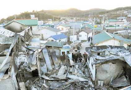 Destroyed houses on the once calm Yeonpyeong Island (Independent)