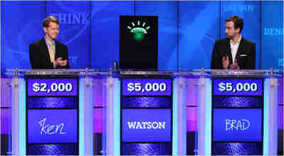Ken Jennings, Watson's avatar, and Brad Rutter prepare to play Jeopardy!