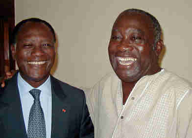Laurent Gbagbo, right, and Alassane Ouattara in 2000, before they became bloody enemies. (Reuters)