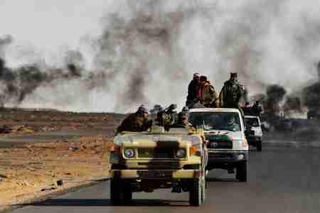 Convoy of rebel fighters in Libya (AFP)