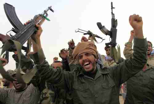 Pro-Gaddafi forces celebrating victory in Ajdabiyah on Wednesday (Reuters)