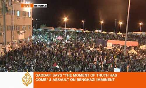 Defiant Benghazi residents shout angry slogans at Gaddafi, as they listen to his speech.