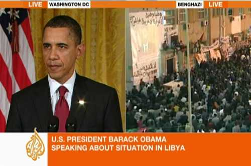 Cheering Benghazi residents watch President Obama live on large screen