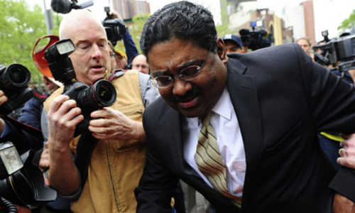 Raj Rajaratnam leaving court after being found guilty (AFP)
