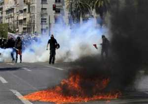 Exploding petrol bombs during clashes with riot police in Athens on Wednesday