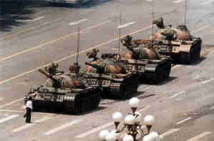 Iconic photo of 'tank man' - student blocking row of tanks in Tiananmen Square