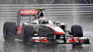 Jenson Button wins the Canadian Grand Prix on Sunday in an upset in the pouring rain (AP)