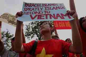 Anti-China protesters in front of the Chinese embassy in Hanoi (AFP)