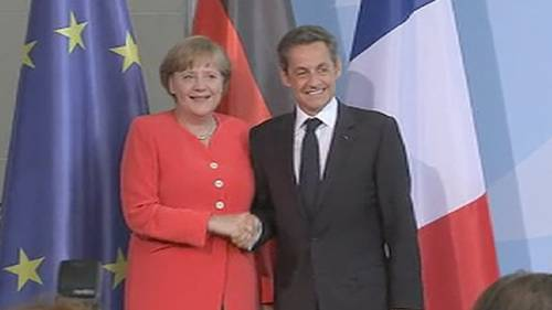 Angela Merkel and Nicolas Sarkozy after Friday's meeting in Berlin