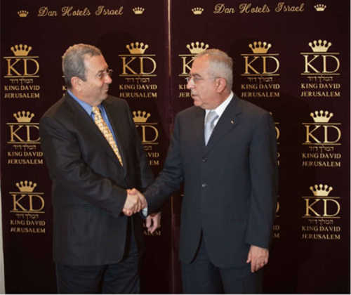 Salam Fayyad and Ehud Barak shake hands at King David Hotel, July 2010 (Ynet)