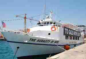 The U.S. flotilla ship 'Audacity of Hope' is being kept from leaving port for Gaza by Greek coast guard