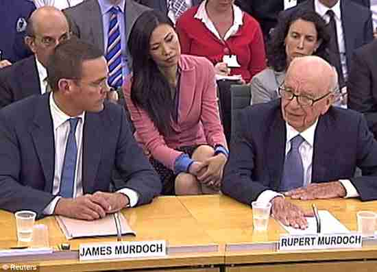 Rupert Murdoch at right, his wife Wendi Deng in the pink jacket, and his son James (Daily Mail)