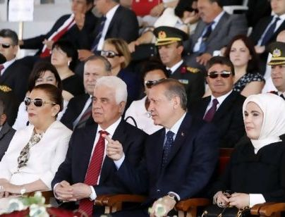 Erdogan and his wife Emine (the only woman wearing a headscarf) in Nicosia, marking the 37th anniversary of Turkish invasion of Cyprus