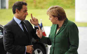 Nicolas Sarkozy and Angela Merkel during negotiations (AFP)