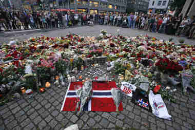 Mourners gather around an improvised shring in Oslo (Reuters)