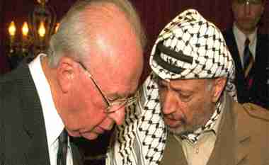 Israeli Prime Minister Yitzhak Rabin and PLO chairman Yasser Arafat signing the Oslo Accords in 1993 (Reuters)