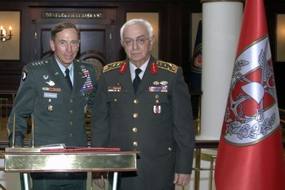 U.S. Gen. David Petraeus (now the designated CIA chief) poses with Turkey's Chief of Staff, Gen. Isik Kosaner, on July 18, 2011 (AP)