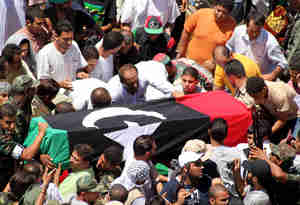 The body of Abdel Fatah Younes is carried through the streets of Benghazi on Friday (Getty)