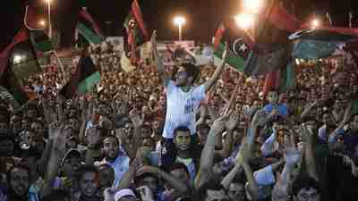 Tens of thousands of Libyans celebrate in Tripoli (AFP)