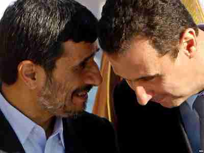 Ahmadinejad conferring with Assad in 2009 (RFERL)