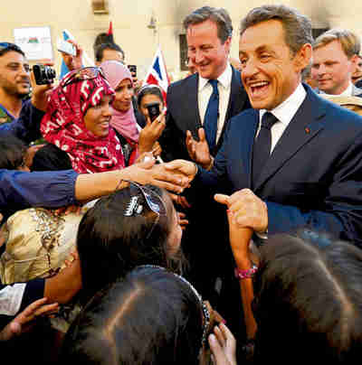 Cameron and Sarkozy meet cheering crowds in Benghazi on Thursday (Reuters)