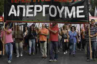 Doctors and medics march during a protest in central Athens on Friday (Reuters)