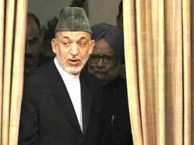 Karzai and Singh arrive for signing of joint statement in New Delhi (AFP)