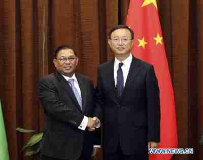 Burma's foreign minister (left) shakes hands with his Chinese counterpart in a visit to Beijing on Tuesday (Xinhua)