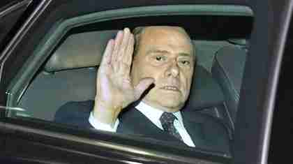 Berlusconi glumly waving last November, after being forced out of office (AP)