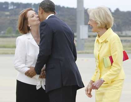 Australian Prime Minister Julia Gillard greets President Obama in Canberra (AP)