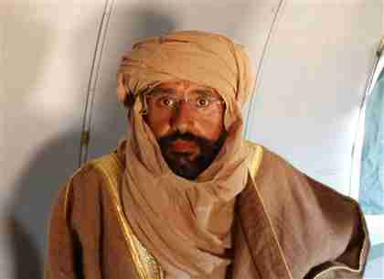 Saif al-Islam Gaddafi is seen sitting in a plane in Zintan on Saturday (Reuters)