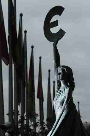 Statue of girl holding the Euro symbol in front of the European Parliament building (Getty)