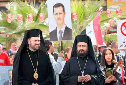 Two Syrian Orthodox priests supporting Bashar al-Assad (AFP)