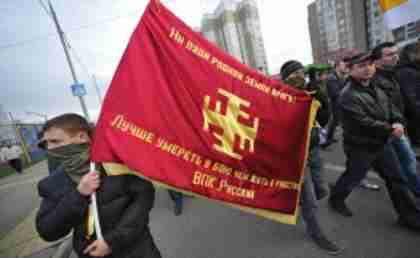 Masked 'Russian March' protesters in Moscow last month