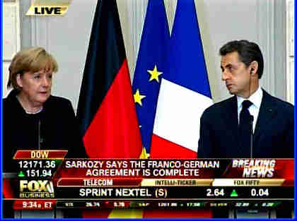 Somber, anxious Merkel and Sarkozy at a press conference on Monday